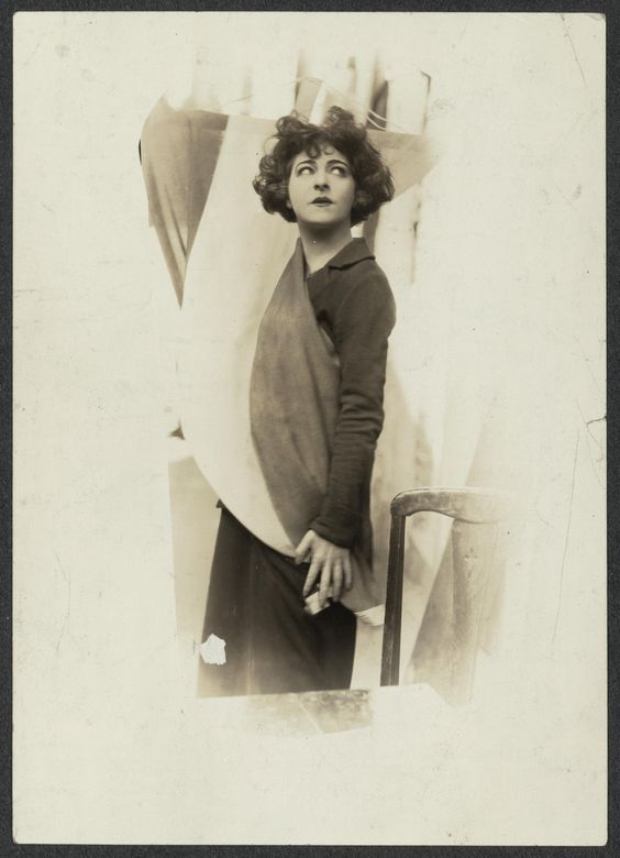 Actress Alla Nazimova dons the purple, white, and gold banner of the National Woman's Party in token of her allegiance to equality for men and women. (1923)