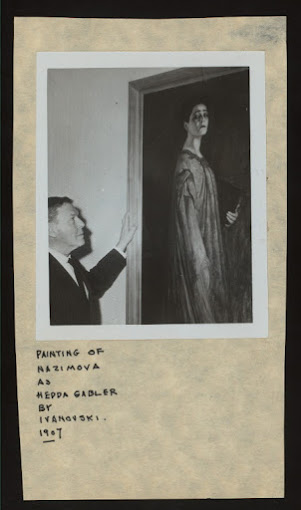 1907: Unknown man viewing painting of Alla Nazimova as Hedda Gabler by Ivanovski