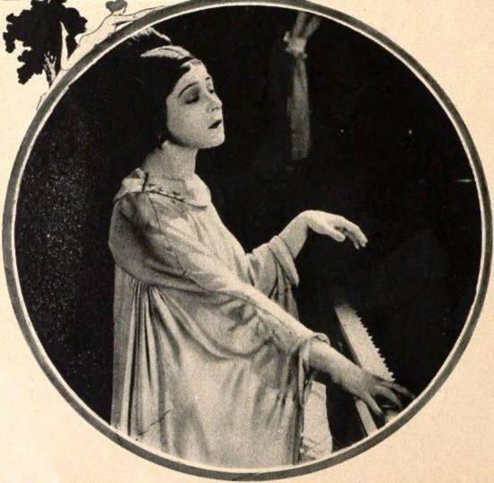 Alla Nazimova at the piano