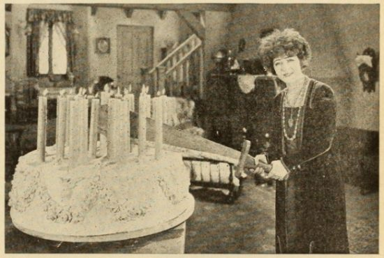 Alla Nazimova cutting her birthday cake with sword (undated)