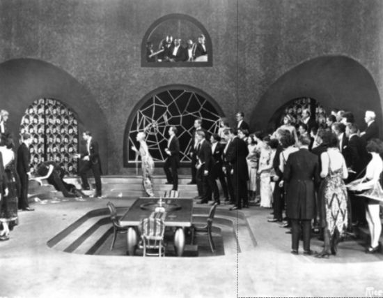 "1921: Alla Nazimova prostrate on the steps in ""Camille"" (1921)"