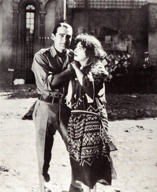 "Alla Nazimova in costume for ""Toys of Fate"" (1918) on the Metro backlot with Rex Ingram, who would later direct Rudolph Valentino in ""The Four Horsemen of the Apocalypse"" (1921)"