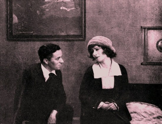"1919: Alla Nazimova receives a visit from Charlie Chaplin on the set of ""The Brat."""