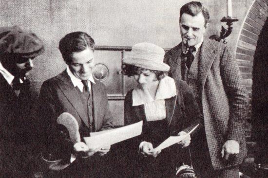 "Charlie Chaplin visits Alla Nazimova and Charles Bryant on the set of ""The Brat"" (1919)"