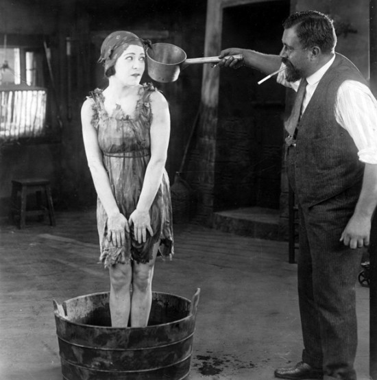 Director Albert Capellani prepares Alla Nazimova for a scene in Eye for Eye