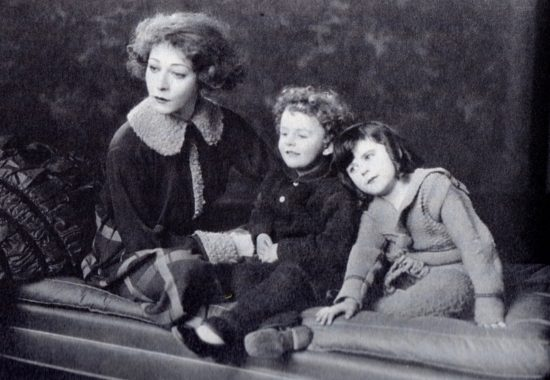 "1922: Alla Nazimova as Nora Helmer with her children in ""A Doll's House"""