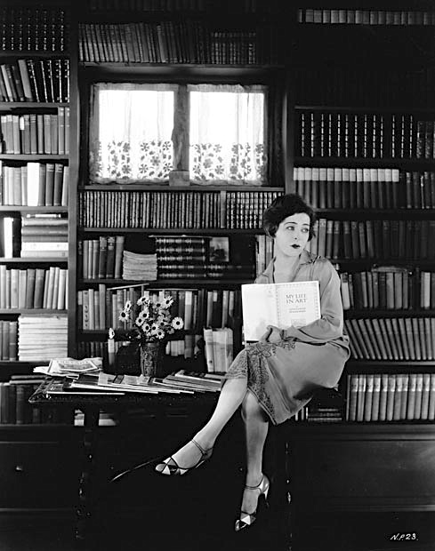 "Alla Nazimova holding book ""My Life In Art"""