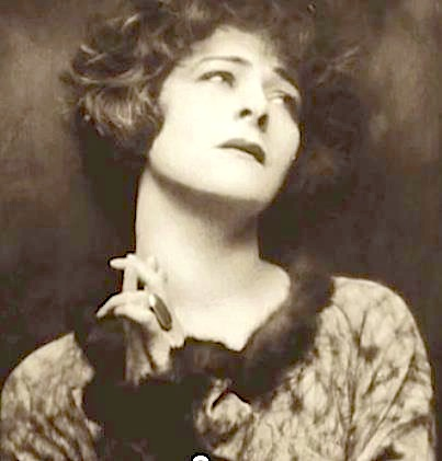 Alla Nazimova with hands clasped together