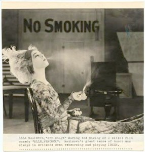 "1920: Alla Nazimova takes a cigarette break on the set ""Madame Peacock."""