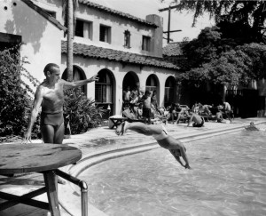 Dick Stagg instructing Terry Miller, 7 at the Garden of Allah Hotel's pool.