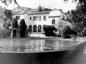 View across the swimming pool to the main building of the Garden of Allah Hotel