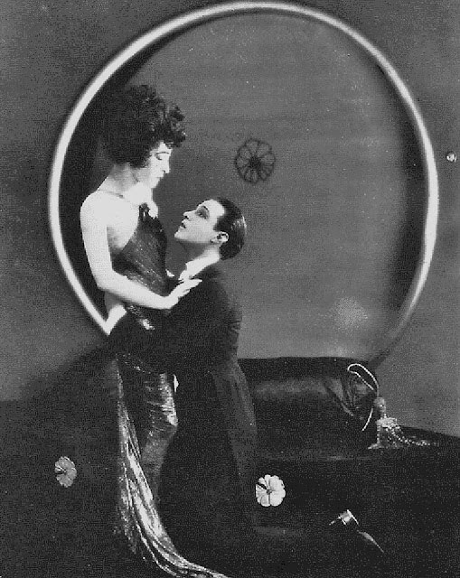 "Nazimova and Valentino in a scene from ""Camille"" that shows designer Natacha Rambova's artistic flair"