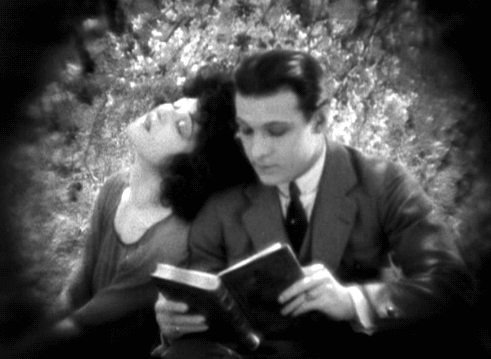 "1921: Rudolph Valentino reading to Alla Nazimova in ""Camille"""